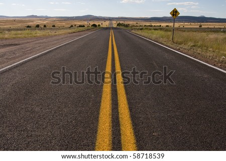 An image of the longest stretch of the original Route 66 highway taken in Arizona - stock photo