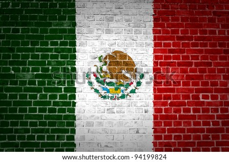 An image of the Mexico flag painted on a brick wall in an urban location - stock photo