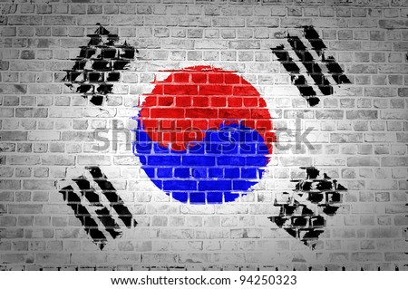An image of the South Korea flag painted on a brick wall in an urban location - stock photo