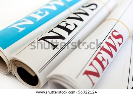 An image of three rolls of newspapers