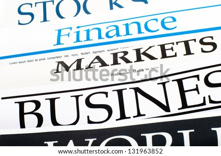 An image of titles of newspapers about the business - stock photo