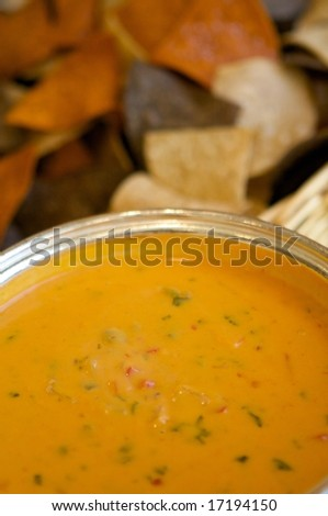 An image of tortilla chips and fresh chili con queso - stock photo
