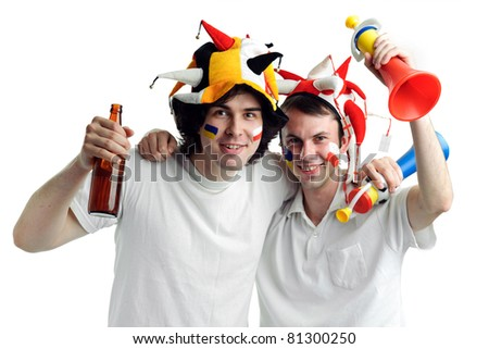 An image of two football fans with a bottle of beer - stock photo