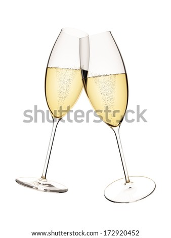 An image of two glasses of sparkling wine isolated on white - stock photo