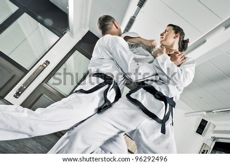 An image of two martial arts fighters - stock photo