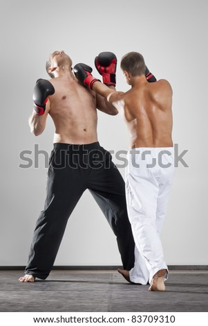 An image of two men box fighting - stock photo