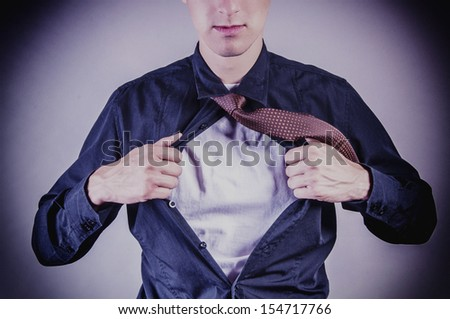 an image of young businessman pulls shirt - stock photo
