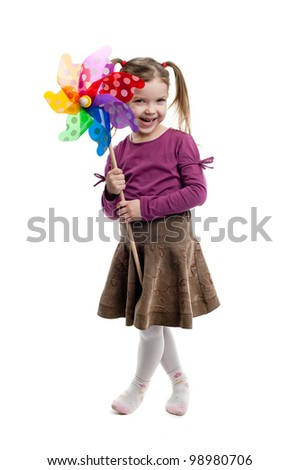 An image of young cute girl holding a wind toy - stock photo