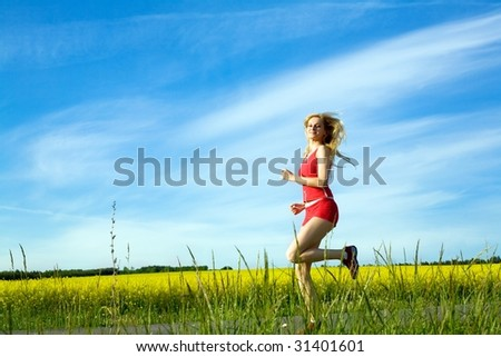 An image of young girl running in the field