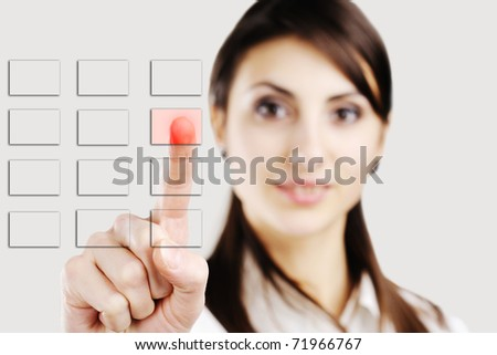 An image of young manager pressing buttons - stock photo