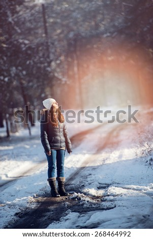 An image of young woman on a walk in snowy winter - stock photo