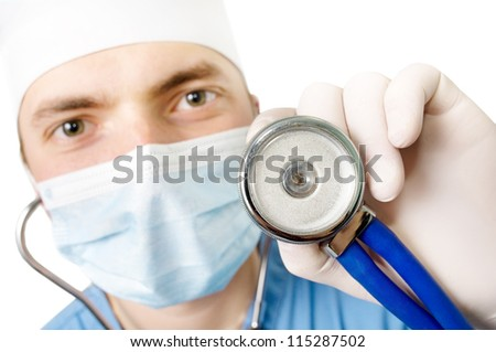 An image professional young doctor with a stethoscope in a hand  on a white background - stock photo