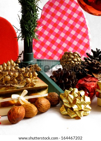 An image showing the spirit of Christmas with Bows, pinecones and nuts / Bows, pinecones and nuts