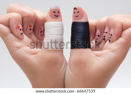 An imitation of wedding by funny painted fingers - stock photo