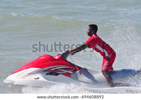An Indian boy riding Jet Ski at the beach of Batu Ferringhi, Georgetown, Penang Island, Malaysia on December 21, 2008.