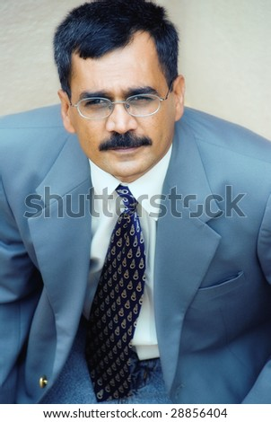 An Indian businessman in a suit - stock photo