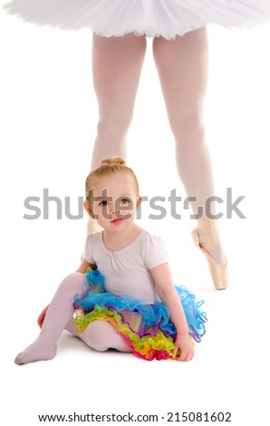 An infant dance child in a tutu with a ballerina's legs in platter tutu - stock photo