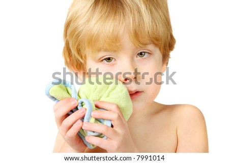 An injured boy holding an ice pack on his lip and cheek - stock photo