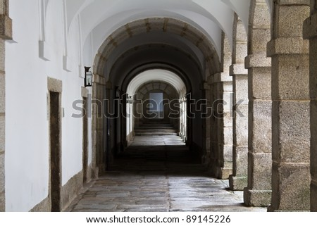 An inner courtyard of the famous renaissance monastery named El Escorial close to Madrid, Spain - stock photo