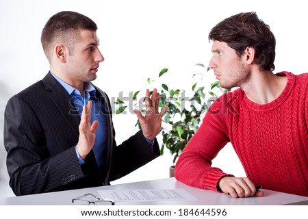 An innocent lawyer and an angry client blaming him - stock photo