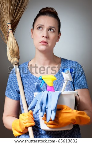 An insecure young woman in a domestic role making a decision and worrying. - stock photo