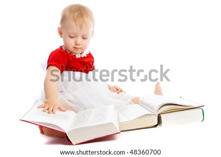 An intelligent toddler reading thick books, isolated - stock photo