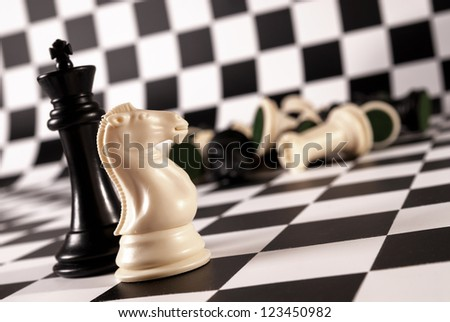 An interesting arrangement of pieces on the chessboard - stock photo