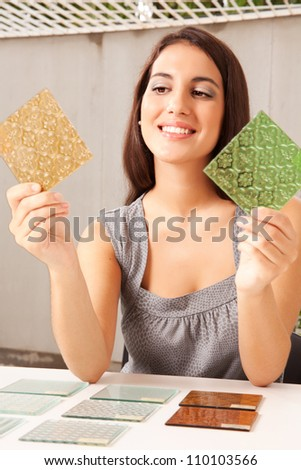 An interior architect / designer choosing a glass tile - stock photo