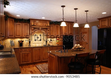 An interior of a beautiful custom kitchen - stock photo