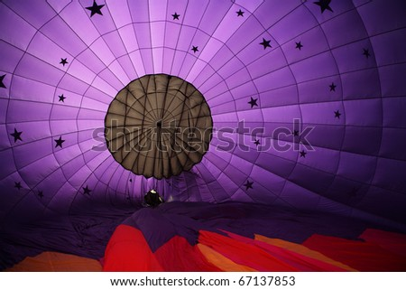 An interior view of a purple hot air balloon inflating - stock photo