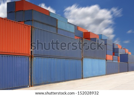 An intermodal container is a standardized reusable steel box used for the safe and movement of materials and  products within a global containerized intermodal freight transport system. - stock photo
