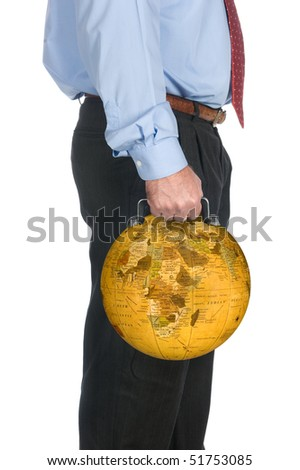 An international businessman carrying his world globe briefcase. - stock photo