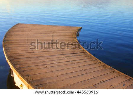an interrupted wood bridge on the lake