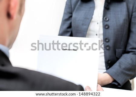 An interview and manager holding curriculum vitae - stock photo