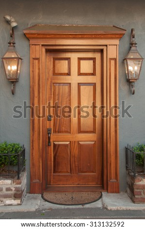 An inviting doorway in the historical district of Charleston, South Carolina. - stock photo