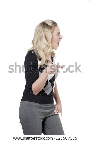 An irritated woman looking in the side of a white background - stock photo