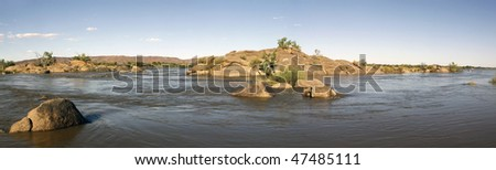 An island in the Orange River near Kakamas next to the Augrabies Waterfall, Northern Cape Province, South Africa, in flood after heavy rains in the catchment areas of the Orange River - stock photo