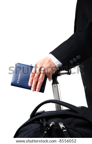 An isolated a travelling businessman carrying a passport and a luggage - stock photo