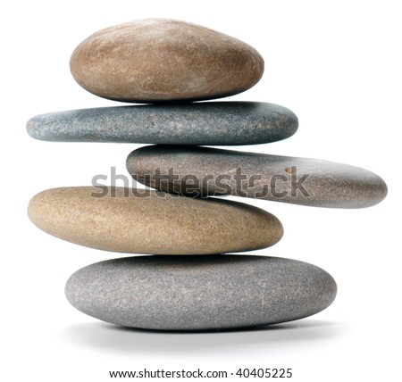 An isolated balanced stone tower on white background - stock photo