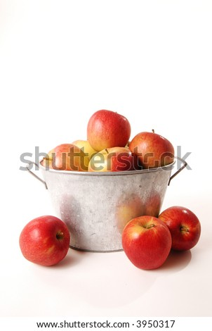 An isolated basket of delicious ripe apples - stock photo