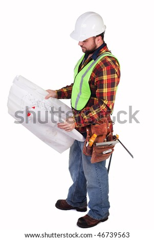 an isolated construction worker looking at some blueprints - stock photo