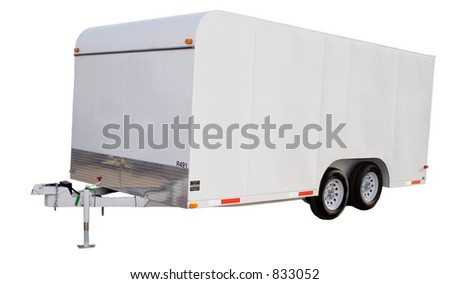 an isolated enclosed trailer - stock photo