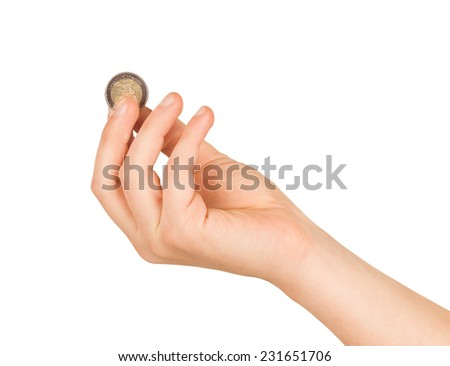 An Isolated image of Euro Coin in a hand - stock photo