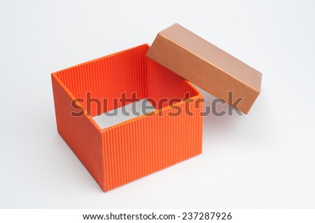 An isolated opened gift box on white background. - stock photo