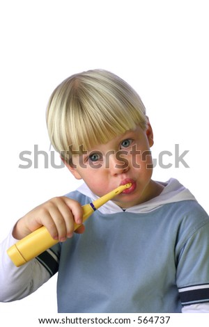 An isolated picture of a young boy cleaning his teeth - stock photo