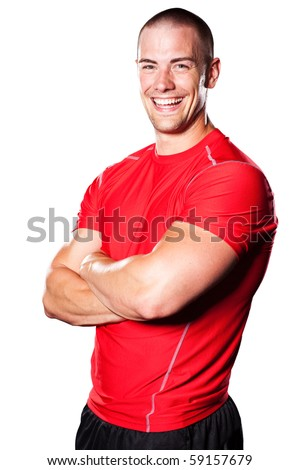 An isolated portrait of a smiling muscular caucasian athlete
