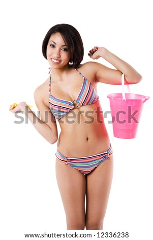 An isolated shot of a beautiful and sexy black woman in bikini carrying a sand bucket