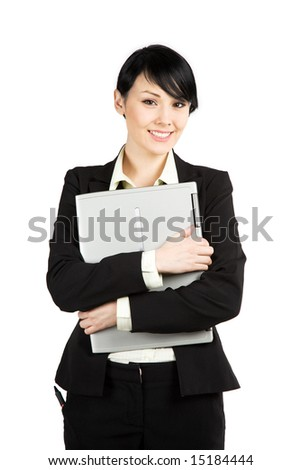 An isolated shot of a beautiful businesswoman carrying a laptop - stock photo