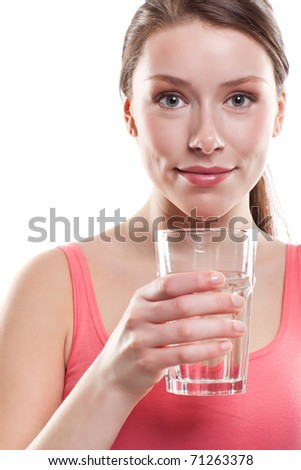 An isolated shot of a beautiful caucasian woman drinking water