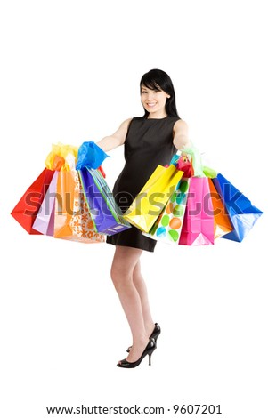 An isolated shot of a beautiful woman carrying shopping bags - stock photo